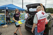 Parchment, Michigan USA, State of emergency declared after high levels of PFAS chemicals found in drinking water. Volunteers from the Red Cross and local High School distributing bottled water to resi... - Jim West - 31-07-2018