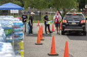 Parchment, Michigan USA, State of emergency declared after high levels of PFAS chemicals found in drinking water. Volunteers from the Red Cross and local High School distributing bottled water to resi... - Jim West - 2010s,2018,aid agency,America,assisting,AUTO,AUTOMOBILE,AUTOMOBILES,AUTOMOTIVE,bottle,bottled,bottled water,bottles,car,carries,carry,carrying,cars,chemical,chemical contamination,chemical exposure,ch