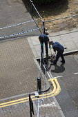 Police forensic team searching the drains with a large magnet after a stabbing of a teenager, Knapp Road, East London - Jess Hurd - 2010s,2018,adolescence,adolescent,adolescents,adult,adults,aged 15,assault,assaults,attack,attacking,attacks,boy,boys,by hand,child,CHILDHOOD,children,cities,City,CLJ,cover,Crime,drain,drains,E3,East,