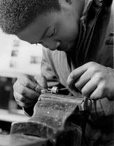 YTS trainee metalworking, Massey Ferguson factory, Banner Lane, Coventry 1983 - John Harris - 1980s,1983,adolescence,adolescent,adolescents,BAME,BAMEs,Black,BME,bmes,boy,boys,child,children,diversity,employee,employees,Employment,ethnic,ethnicity,FACTORIES,factory,job,jobs,LBR,male,man,men,min