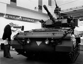 Visitor looking at a FV107 Scimitar on the Alvis stand, The Falklands Experience, Expo'83 Defence Components Exhibition Brighton 1983 - John Harris - 1980s,1983,Alvis,armed,Armed Forces,armored,armoured,armoured personnel carrier,armoured vehicle,arms,Arms industry,arms selling,arms trade,army,buy,buyer,buyers,buying,capitalism,capitalist,Combat Ve