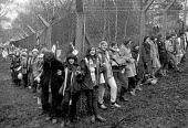 Embrace the Base protest RAF Greenham Common 1982, 30,000 women joining hands around USAF American Airforce base from which cruise missiles are deployed - John Harris - 1980s,1982,activist,activists,against,Air force,Airbase,airbases,Airforce,American,americans,anti war,Antiwar,armed forces,atomic,bomb,BOMBS,Campaign,Campaign for Nuclear Disarmament,campaigner,campai