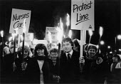 Health Workers Day torchlit protest at underfunding of the NHS, York 1988 Roger Poole NUPE (C) - John Harris - 03-02-1988