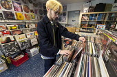 Teenager browsing in a record shop, Leamington Spa, Warwickshire - John Harris - 2010s,2018,ACE,adolescence,adolescent,adolescents,Arts,bought,buy,buyer,buyers,buying,choice,choosing,commodities,commodity,consumer,consumers,Culture,customer,customers,deciding,decisions,EBF,Economi