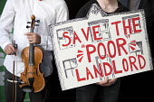 Newly formed London Renters Union ironic protest at the Resident Future Renting Landlords Association conference with violins and a spoof cheque. The conference discussed what they describe as the inc... - Jess Hurd - 2010s,2018,activist,activists,CAMPAIGNING,CAMPAIGNS,cheque,College,COLLEGES,conference,conferences,DEMONSTRATING,demonstration,DEMONSTRATIONS,environment,funny,Future Renting,hostile environment,Housi