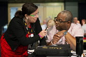 GMB delegates in discussion, TUC conference 2018 Manchester - John Harris - 2010s,2018,BAME,BAMEs,BEMM,BEMMS,Black,BME,bmes,conference,conferences,delegate,delegates,delegation,diversity,ethnic,ethnicity,FEMALE,GMB,Manchester,minorities,minority,people,person,persons,POC,trad