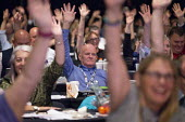 Delegates voting TUC conference 2018 Manchester - John Harris - 2010s,2018,conference,conferences,DELEGATE,Delegates,democracy,Hands up,Manchester,people,trade union,trade unions,trades union,trades unions,TUC,TUC congress,Vote,Votes,Voting