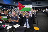 Dave Prentis UNISON holding up I Support Palestine placard TUC conference 2018 Manchester - John Harris - 2010s,2018,conference,conferences,delegate,delegates,delegation,flag,flags,Gen Sec,Manchester,palestine,placard,PLACARDS,trade union,trade unions,trades union,trades unions,TUC,TUC congress,UNISON
