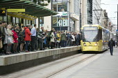 Passengers waiting as a tram arrives at a stop, Manchester - John Harris - 10-09-2018