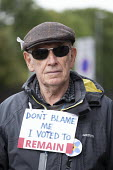 Man wearing a Don't Blame Me I Voted Remain sign around his neck, The World Transformed, Labour Party Conference, Liverpool - John Harris - 2010s,2018,activist,activists,age,ageing population,brexit,CAMPAIGN,campaigner,campaigners,CAMPAIGNING,CAMPAIGNS,Conference,conferences,elderly,EU,European Union,Left,left wing,Leftwing,Liverpool,male