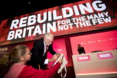 Jeremy Corbyn signing his autograph for a delegate Labour Party Conference, Liverpool, 2018 - Jess Hurd - 2010s,2018,autograph,AUTOGRAPHS,Conference,conferences,delegate,DELEGATES,interacting,interaction,Jeremy Corbyn,Labour Party,Labour Party Conference,Liverpool,MP,MPs,Party,Pier,pol,political,politicia