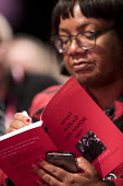 Diane Abbott MP signing a Keir Hardie book Labour Party Conference, Liverpool, 2018 - Jess Hurd - 2010s,2018,BAME,BAMEs,Black,BME,bmes,Conference,conferences,Diane Abbott,diversity,ethnic,ethnicity,FEMALE,interacting,interaction,Keir Hardie,Labour Party Conference,Liverpool,minorities,minority,MP,