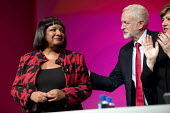 Diane Abbott MP speaking Labour Party Conference, Liverpool, 2018 with Jeremy Corbyn - Jess Hurd - 2010s,2018,applauding,applause,BAME,BAMEs,Black,BME,bmes,Conference,conferences,Diane Abbott,diversity,ethnic,ethnicity,FEMALE,Labour Party Conference,Liverpool,minorities,minority,Party,people,person
