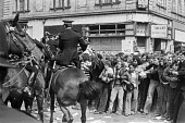 Battle of Lewisham 1977. Mounted Police trying to clear the route for the National Front march, London - NLA - ,1970s,1977,activist,activists,adult,adults,against,ALCARAF,animal,animals,Anti Fascist,Anti Racism,anti racist,anti-fascists,BAME,BAMEs,Battle of Lewisham,bigotry,Black,BME,bmes,CAMPAIGN,campaigner,c