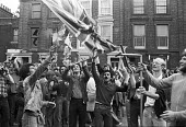 Battle of Lewisham 1977. Protest against the National Front march burning a captured NF banner - NLA - ,1970s,1977,activist,activists,adult,adults,against,ALCARAF,Anti Fascist,Anti Racism,anti racist,anti-fascists,BAME,BAMEs,banner,banners,Battle of Lewisham,bigotry,Black,BME,bmes,burn,burning,BURNS,CA