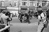 Battle of Lewisham 1977. News cameramen filming Police making arrests and trying to clear the streets for a National Front march - NLA - 13-08-1977