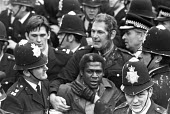 Battle of Lewisham 1977. Police arresting protestors and trying to clear the streets for a National Front march, South London - NLA - ,1970s,1977,activist,activists,adult,adults,against,ALCARAF,Anti Fascist,Anti Racism,anti racist,anti-fascists,arrest,arrested,arresting,BAME,BAMEs,Battle of Lewisham,bigotry,Black,BME,bmes,CAMPAIGN,c