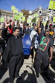 Windrush generation funeral march protest, Birmingham. Protesters carrying a coffin in protest at the treatment of the Windrush generation - John Harris - 29-09-2018