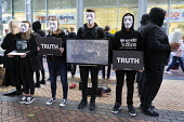 Animal Rights protest by Anonymous for the Voiceless. The Cube of Truth showing videos of animal cruelty, outside Tesco supermarket, Birmingham - John Harris - 2010s,2018,abuse,activist,activists,against,agricultural,agriculture,animal,Animal Rights,Animal Welfare,animals,Anonymous,Birmingham,campaign,campaigner,campaigners,campaigning,CAMPAIGNS,capitalism,c