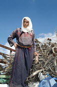 Occupied Palestinian Territories: Shilo Valley, West Bank. one of two Palestinian sisters who farm alone surrounded by Jewish settlers, Na'ma F'dea aged 60 years old getting firewood in for winter - Joanne O'Brien - 03-10-2013