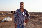 Bedouin farmer Aziz al-Touri, trying to save his village, Al-Araqib, Negev Desert, Israel, which has been demolished over 110 times since 2010 by Israeli authorities seeking to evict the Bedouins from... - Joanne O'Brien - , bedouins, farming,2010s,2013,AGRICULTURAL,agriculture,arab,arabs,bedouin,cracked,desert,dry,evicting,eviction,evictions,FARM,farmed,farmers,farming,farms,ground,Human Rights,israel,Israeli,land,male