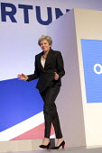 Theresa May dancing her way onto the stage. Theresa May speaking Conservative Party Conference, Birmingham, 2018 - Jess Hurd - 2010s,2018,Birmingham,Conference,conferences,CONSERVATIVE,Conservative Party,Conservative Party Conference,conservatives,dance,DANCER,DANCERS,dancing,FEMALE,MP,MPs,music,Party,people,person,persons,PO