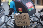 Take away food delivery workers strike for better pay, Bristol. The workers want a minimum of £5 per delivery, paid waiting times at restaurants of 17p per minute, a freeze on hiring new riders and g... - Paul Box - 2010s,2018,activist,activists,against,backpack,bicycle,bicycles,BICYCLING,Bicyclist,Bicyclists,BIKE,BIKES,CAMPAIGN,campaigner,campaigners,CAMPAIGNING,CAMPAIGNS,conditions,contracts,Courier,Couriers,cy