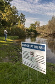 Michigan USA: Sign warning anglers Do not Eat The Fish, Huron River, Island Lake State Recreation Area. High levels of carcinogenic PFAS chemicals have been found in the water. PFAS have been widely u... - Jim West - 03-10-2018
