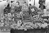 Fruit and Vegetable stall, London 1976 - NLA - 1970s,1976,box,boxes,buy,buyer,buyers,buying,cities,City,Cost of living,decimal,decimalisation,EBF,Economic,Economy,employee,employees,Employment,food,FOODS,job,jobs,LBR,London,Low Pay,market,market s