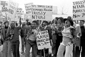 The cast of a touring South African musical play, Ipi Tombi, protest against Apartheid and the arrest of Trusty Ntuli and other black leaders, South Africa House, Trafalgar Square, London 1976 - NLA - 03-12-1976