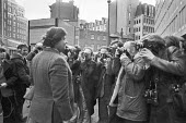 Martin Webster, National Front, surrounded by photographers as he goes into Scotland Yard, London 1978 - NLA - 23-02-1978
