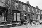 Construction workers bricking up a terraced house, Liverpool - NLA - 1970s,1978,BRICK,bricked up house,bricks,building,Building Worker,buildings,cities,City,derelict,DERELICTION,disused,EBF,Economic,Economy,employee,employees,Employment,empty,house,houses,Housing,housi