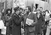 Astrid Proll extradition case, the Old Bailey, London 1978. Larry Grant of the NCCL, acting for Astrid Proll, with demonstrators behind, talking to a senior Police Officer - NLA - 10-10-1978
