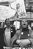 Zimbabwe must be free, protest 1979 outside a conference in London on the future of the country - NLA - 1970s,1979,activist,activists,against,CAMPAIGNING,CAMPAIGNS,conference,conferences,DEMONSTRATING,Demonstration,FEMALE,free Zimbabwe,independence,London,outside,people,person,persons,placard,placards,P