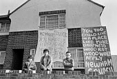 Protest by tenants damp council housing Newham, East London 1980. One family make a protest. - NLA - 1980,1980s,activist,activists,against,banner,banners,CAMPAIGNING,CAMPAIGNS,cities,City,council,Council Housing,Council Services,Council Housing,Council Services,damp,DEMONSTRATING,Demonstration,famili