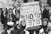 Health workers protest against longer hours, London 1980. Radiographers, physiotherapists and hospital technicians against cuts, proposals for a longer working day contained in a report by industrial... - NLA - 1980,1980s,activist,activists,against,CAMPAIGNING,CAMPAIGNS,Clegg Report,cuts,DEMONSTRATING,Demonstration,FEMALE,health,HEALTH SERVICES,Health Worker,health workers,healthcare,HOSPITAL,hospital techni