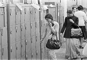 Decca, Battersea, South London, 1980. The private lockers of employees are left in street outside the factory after its closure for them to collect their belongings. - NLA - 1980,1980s,Asian,Asians,BAME,BAMEs,Black,BME,bmes,close,closed,closing,closure,closures,Decca,deindustrialisation,deindustrialization,diversity,DOWNTURN,EBF,Economic,economic crisis,Economy,employee,e