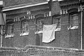 Unrest at HMP Wormwood Scrubs, West London 1980, with accusations of brutality and with prisoners going onto roofs and throwing rubbish from windows - NLA - 1980,1980s,activist,activists,against,banner,banners,brutality,brutality in prisons,CAMPAIGNING,CAMPAIGNS,CLJ,Criminal Justice System,DEMONSTRATING,Demonstration,imprisonment,incarcerated,incarceratio