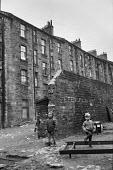 Boys playing in courtyard, Glasgow tenement 1971 - Martin Mayer - 1970s,1971,boy,boys,child,CHILDHOOD,children,cities,City,excluded,exclusion,Glasgow,HARDSHIP,home,homes,HOUSING,Housing Estate,impoverished,impoverishment,INEQUALITY,juvenile,juveniles,kid,kids,male,M