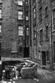 Rubbish bins, Glasgow tenement 1971 - Martin Mayer - 1970s,1971,cities,City,excluded,exclusion,Glasgow,HARDSHIP,home,homes,HOUSING,Housing Estate,impoverished,impoverishment,INEQUALITY,Marginalised,people,play,play area,playing,POOR,poor conditions,pove