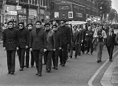 Funeral of Michael Gaughan, 1974 an Official IRA volunteer who died in Parkhurst prison after a 64 day hunger strike during which he was force fed. The procession passing through Kilburn, London - Martin Mayer - 1970s,1974,catholic,catholics,dead,death,deaths,died,disputes,force fed,force feeding,funeral,FUNERALS,hunger,hunger strike,hunger striker,imprisonment,incarcerated,incarceration,INMATE,INMATES,IRA,ja