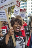 Oakland, California, USA Unite Here Hotel workers on strike against low wages, The Marriott City Center Hotel. Many workers take an additional job to make a living wage. Workers are striking Marriott... - David Bacon - 05-10-2018