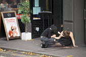 Helping a drunk drunk friend in the street outside a bar, Reading, Berkshire - John Harris - 13-10-2018