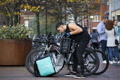Deliveroo worker, Shopping Centre, Reading, Berkshire - John Harris - 13-10-2018