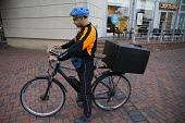 Ubereats delivery rider checking his App, Shopping Centre, Reading, Berkshire - John Harris - 13-10-2018
