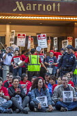 San Francisco, USA Hotel workers striking against low pay sit-in outside Marriott Marquis Hotel. The low wages force many workers to work an additional job - David Bacon - 12-10-2018