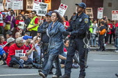 San Francisco, USA Hotel workers striking against low pay sit-in outside Marriott Marquis Hotel and are arrested by Police. The low wages force many workers to work an additional job. - David Bacon - 12-10-2018