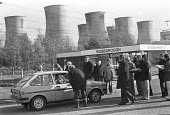 Power workers picketing Eggborough Power Station, North Yorkshire 1977 - Peter Arkell - 1970s,1977,Cooling Towers,DISPUTE,disputes,Eggborough,GMB,GMWU,Industrial dispute,male,man,member,member members,members,men,people,person,persons,Picket,Picket Line,picketing,pickets,Power Station,St