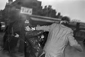 Defendant in Bank of England fraud case assulting a press photographer, Bow Street Maginstrates Court, London 1976 - Ray Rising - 18-12-1976