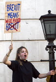 Peoples Vote March for the Future. London protest demanding a second referendum on the Brexit deal. Young protestors shout their message from Government buildings in Whitehall - Stefano Cagnoni - 2010s,2018,activist,activists,against,BREXIT,buildings,CAMPAIGNING,CAMPAIGNS,Democracy,DEMONSTRATING,demonstration,EU,Europe,European,European flag,European Union,europeans,FEMALE,FLAG,flags,Governmen